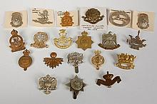 TWENTY ASSORTED BRITISH MILITARY CAP BADGES