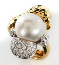 A 14K PEARL AND DIAMOND RING