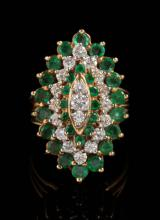 AN 18K GOLD EMERALD AND DIAMOND COCKTAIL RING