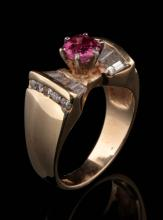 A 14K GOLD THAI RUBY AND DIAMOND FASHION RING