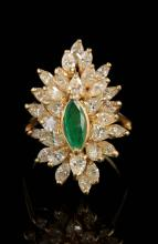AN 18K MARQUIS CUT EMERALD AND DIAMOND COCKTAIL RING