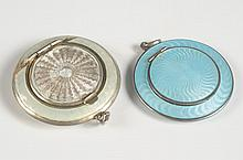 TWO GUILLOCHE COMPACT PENDANTS, ONE MARKED STERLING