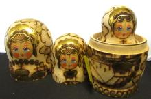 7 Russian Gold Painted Nesting Dolls