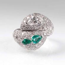 An emerald diamond ring