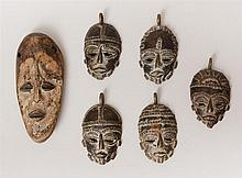 Five African Brass Miniature Face Mask Pendants and a Lugea (Congo) Carved and Painted Wood Mask