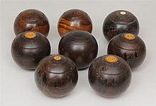 Group of Hardwood Carpet Balls
