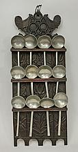 French Provincial Relief-Carved Oak Spoon Rack with Twelve Pewter Cream Soup Spoons