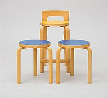 TWO ALVAR AALTO MODEL 60 BENTWOOD LAMINATE STACKING STOOLS AND A BENTWOOD LOW BACK STOOL