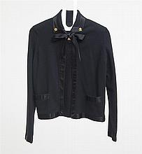 BLACK CARDIGAN WITH SILK NECKTIE AND CHANEL-TYPE COLLAR BUTTONS, LACKING LABEL, PROBABLY CHANEL