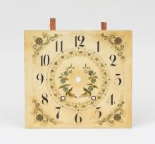 Two Painted Wood Clock Faces and a Brass Fire Fender
