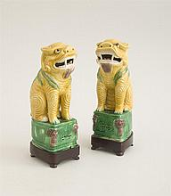 PAIR OF CHINESE GLAZED BISCUIT FIGURES OF SEATED FU DOGS