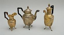 TWO EMPIRE SILVER-GILT INDIVIDUAL COFFEE POTS AND A MATCHING CREAMER