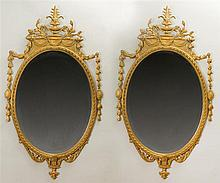 Pair of George III Style Carved Gilt Gesso and Wood Oval Mirrors