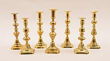 Three Pairs of English Brass Table Candlesticks and a Single Candlestick