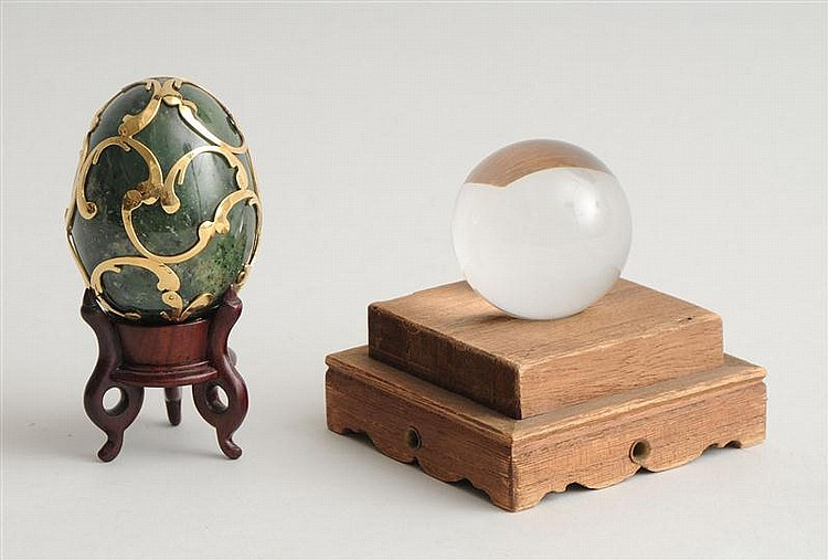 GOLD-MOUNTED JADE EGG AND A ROCK CRYSTAL SPHERE