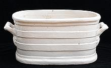 CONTINENTAL IVORY-GLAZED POTTERY TWO-HANDLED TUB