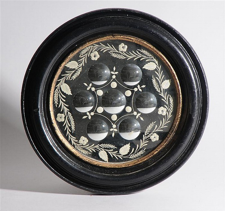 Two English Reverse-Engraved Circular Mirrors in Ebonized and Walnut Frames