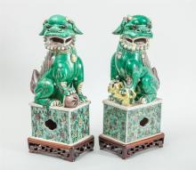 PAIR OF CHINESE GLAZED BISCUIT FIGURES OF FU DOGS