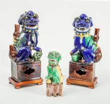 ASSEMBLED PAIR OF CHINESE BLUE-GLAZED FIGURES OF FU DOGS AND A SINGLE GREEN-GLAZED DOG