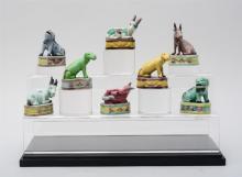 GROUP OF EIGHT CHINESE GLAZED PORCELAIN ANIMALS