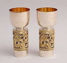 PAIR OF ENGLISH HAMMERED SILVER AND SILVER-GILT GOBLETS