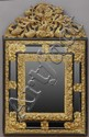 DUTCH BAROQUE STYLE REPOUSSÉ BRASS MOUNTED EBONIZED WOOD MIRROR