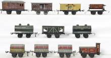 Group of Bing O gauge rolling stock freight