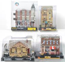 4 Woodland Scenics O gauge buildings emporium,  store, cobbler, and country store