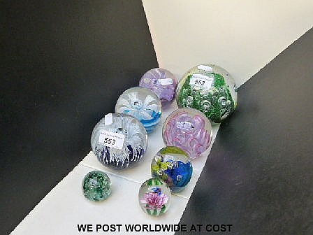 Seven various paperweights.