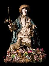 Divine Shepherd.Clothed polychrome wooden carving.
