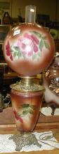 HAND PAINTED GLASS LAMP, NOTE CHIPS ON GLOBE. CONVERTED