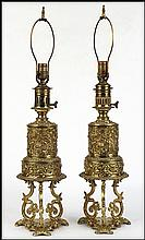 PAIR OF PRESSED METAL OIL LAMPS.