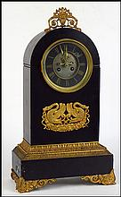BRONZE AND SLATE MANTLE CLOCK.