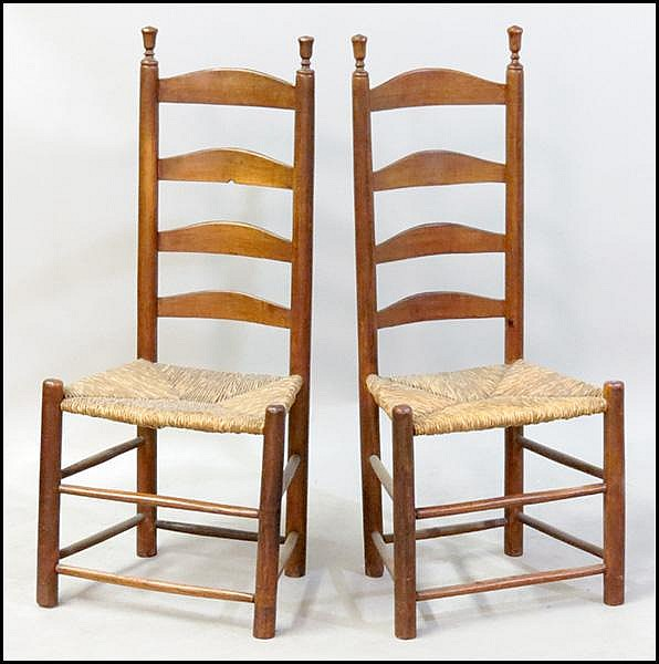 PAIR OF AMERICAN LADDER BACK SIDE CHAIRS.