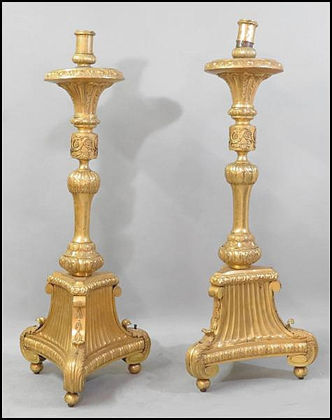 PAIR OF FRENCH GILT COPPER TORCHIERES.