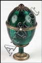 RUSSIAN FABERGE ENAMEL EGG ON STAND.