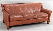 CONTEMPORARY CENTURY LEATHER THREECUSHION SOFA.