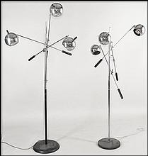 TWO MIDCENTURY CHROME AND METAL THREELIGHT FLOOR LAMPS.
