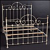PAINTED IRON AND BRASS BED FRAME.