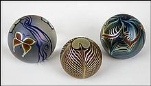 THREE CORREIA ART GLASS PAPERWEIGHTS.