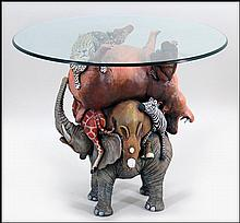 A JEFF RAASCH PAINTED COMPOSITE ANIMAL FORM TABLE.