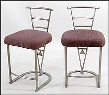 PAIR OF DESIGN INSTITUTE BRUSHED METAL BAR STOOLS.
