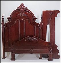 CARVED MAHOGANY HEADBOARD AND FOOTBOARD.