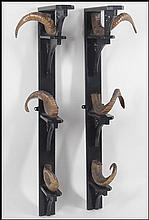 A PAIR OF ENGLISH GUN RACKS.