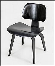 A BLACK EAMES MOLDED PLYWOOD LCW CHAIR.
