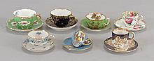 COLLECTION OF TEACUPS AND DEMITASSE CUPS WITH MATCHING SAUCERS.
