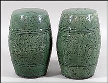 A PAIR OF CHINESE CELADON GLAZED GARDEN SEATS.