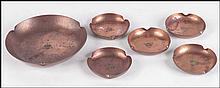 SET OF FIVE ROYCROFT HAMMERED COPPER DISHES.