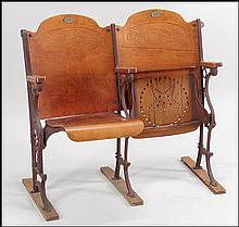TWO WOOD AND IRON SECTIONED THEATER SEATS.