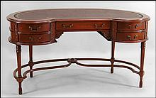 MAHOGANY KIDNEY FORM DESK.